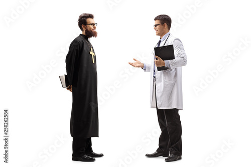 Fotografie, Obraz Full length shot of a young male doctor discusiing something with a priest