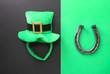 Leinwanddruck Bild - Leprechaun's hat and horseshoe on color background. St. Patrick's Day celebration