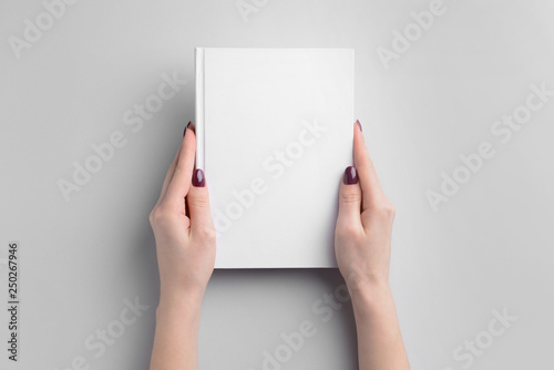 Female hands with book on light background Fototapet