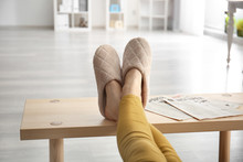 Young Woman In Slippers Restin...