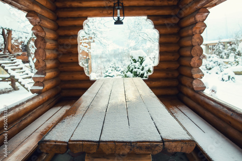 Wooden alcove with big table outdoors Wallpaper Mural