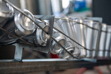 Conveyor For Bottling Beer In Aluminum Cans. Close Up