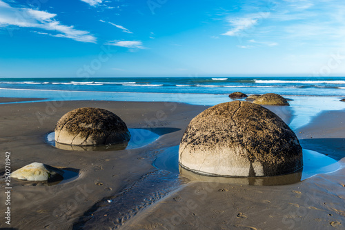 Landmark on the east coast of the South Island, Moeraki Boulders under a dramatic dawn sky Canvas Print