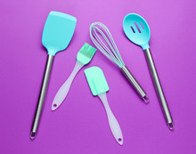 Silicone Tools With Metal Handles For Cooking On Purple Background