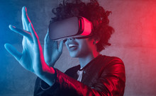 Excited Girl Wearing VR Headset In Neon Light