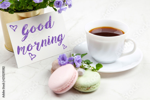 Fotografia Good Morning postcard on white marble table