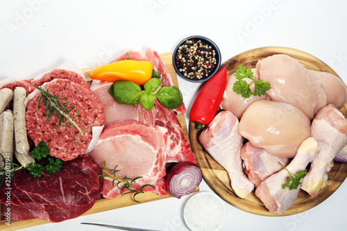 Staande foto Vlees raw meat. Different types of raw pork meat, chicken and beef with spices and herbs