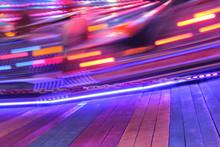 Disco Lights Synthwave Neon Fairground Ride Night Lights Funfair Amusement Park Moving, Light Trails, Slow Shutter-speed Long Exposure Illuminations Futuristic Sci Fi