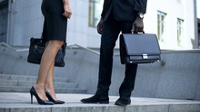 Managers Talking Near Office, View On Leather Shoes And Briefcase Business Style