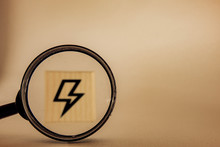 Magnifying Glass Zooming In On Lightning Icon