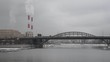Winter cityscape in Moscow: Moskva river, buildings, bridge and chimneys