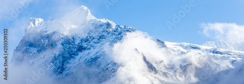 snow covered icy mountain peaks Fototapeta