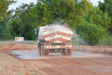 Water Truck Sprays Water For A New Road Construction Site.