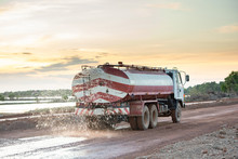 Water Truck Sprays Water For A...