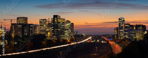 Fotografia Sunset cityscape of Zuidas the business and commercial  zone of Amsterdam