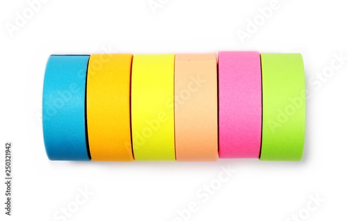 Fotografía  Clear colorful adhesive tape isolated on white background, top view