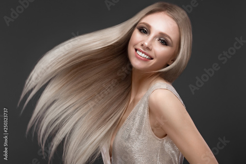 Leinwand Poster Beautiful blond girl in move with a perfectly smooth hair, and classic make-up