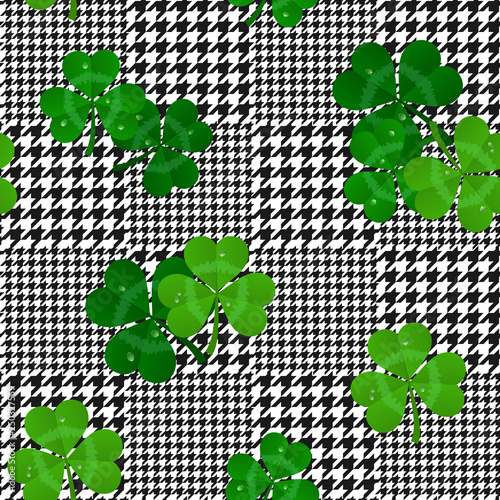 Photo  vector houndstooth seamless black and white pattern with green shamrocks