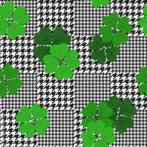 vector houndstooth seamless black and white pattern with green shamrocks Canvas Print