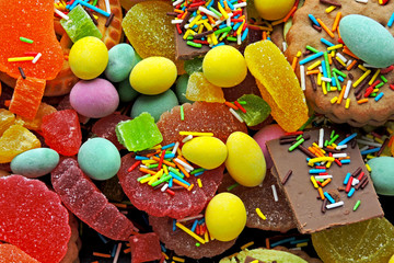 Fototapeta na wymiar A set of colorful candies and sweets. Celebration with sweets. Junk food. Foods that contain excessive amounts of sugar. Diabetes concept. Prohibited foods with diet and diabetes. Glucose. Fast carbs.