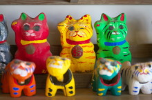 Chiba,Japan-February 19, 2019: Papier Mache Beckoing Cat Or Fortune Cat Or Figure Of A Cat With One Paw Raised Or Maneki Neko.