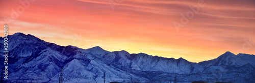 Poster Corail Sunrise of Winter panoramic, view of Snow capped Wasatch Front Rocky Mountains, Great Salt Lake Valley and Cloudscape from the Mountain view Corridor Highway. Utah, USA.