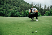 Golfer Stress And Sit On The G...