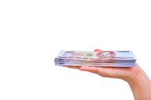 1,000 Baht Thai Money Hold In Hand Isolated On A White Background