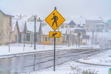 Pedestrian Crossing Sign On An Icy Road In Utah