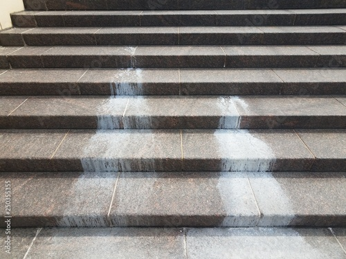 Fotografering  spilled white liquid mess on stairs or steps