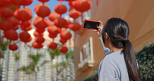 Woman Take Photo On Cellphone For Red Lantern