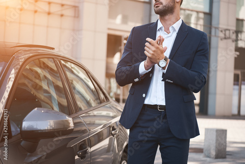 Obraz na płótnie Young businessman near new car wating for meeting
