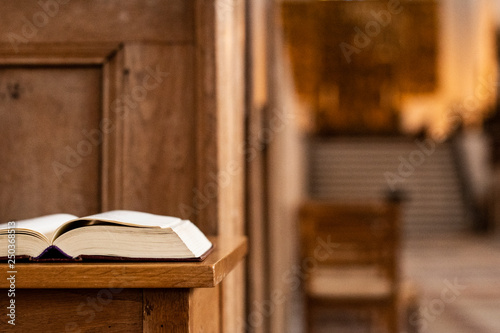 Fototapeta  Holy book in front on a desk  inside  the church, closeup