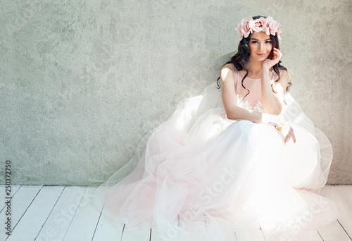 Stampa su Tela Beautiful bride woman in tulle roses wedding dress, lifestyle portrait
