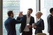 Leinwanddruck Bild - Happy executives give high five during friendly talk in office