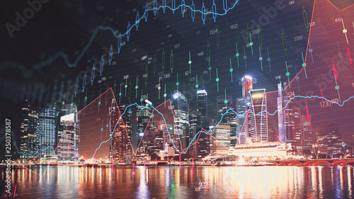 Fototapeta Trading graph on the cityscape at night background. Business and financial concept. Double exposure. Singapore