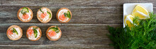 Tartlets With Cream Cheese And Salted Salmon On A Wooden Background. Tasty Light Snack For A Party. Finger Food. The Top View. Banner.