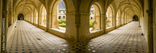 Large panorama of porches and arches in a convent in France Canvas Print