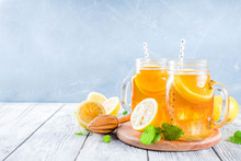 Iced Summer Drink, Tea With Lemon Slices And Mint, Rustic Wooden Background Copy Space