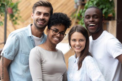 Attractive happy multiracial people posing looking at camera Canvas Print