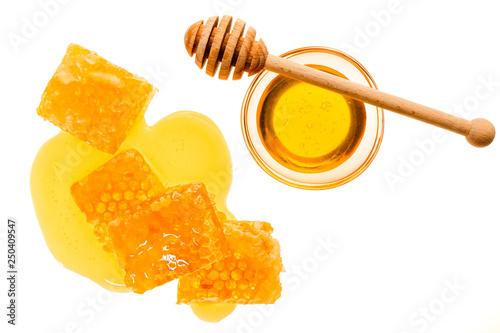 Photo  Honiglöffel mit mehreren Honigwaben von Oben