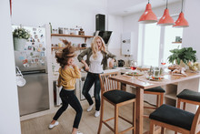 Cheerful Mother And Daughter Having Fun At Home