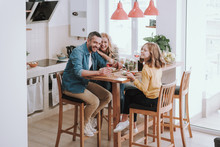 Happy Family Spending Time Together And Enjoying Dinner At Home