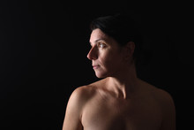 Portrait Of Middle Aged Woman On Black Background
