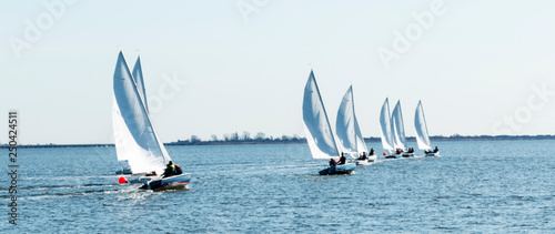 Leinwand Poster Sailboats racing in a regatta in the winter