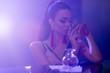 canvas print picture - sensual brunette woman in nightclub bar