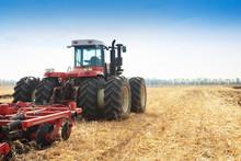Modern Tractor In The Field Du...