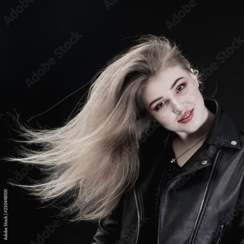 portrait of a young girl with flowing hair in the studio