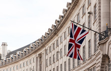 British Flag On The Background Of The Historic Building Of London, UK