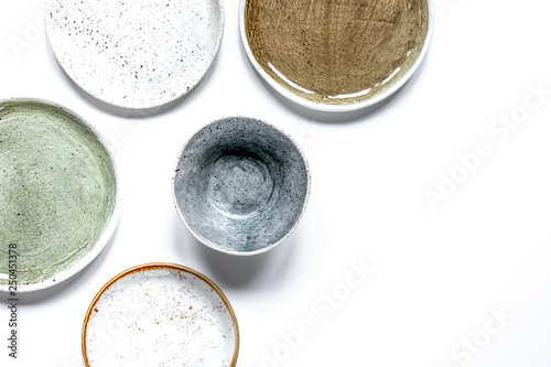 ceramic tableware top view on white background mock up Wallpaper Mural
